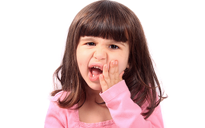 Child with a sensitive tooth